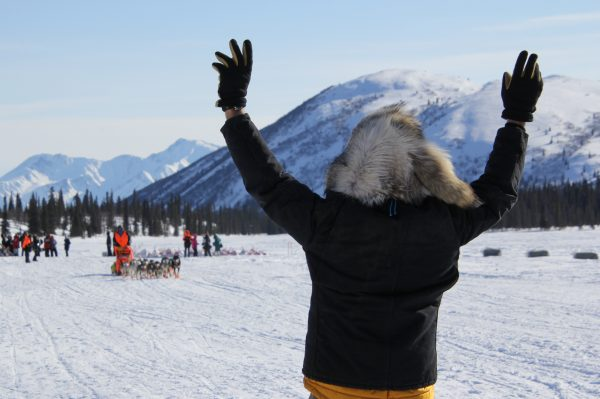 A  man waves his arms