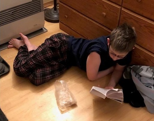 14-year-old Jack Roberts reads in his home. His mom Jamie homeschools him and his 16-year-old sister Renee. (Courtesy of Jamie Roberts)