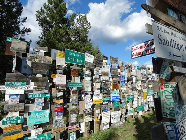 A bunch of signs on a garden