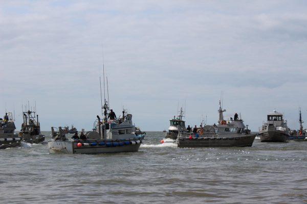 Several 30-foot fishing boatsin the water
