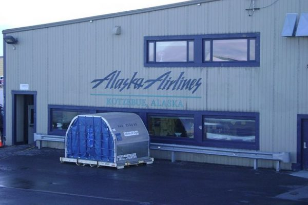 A beige building with the blue words Alaska Airlines