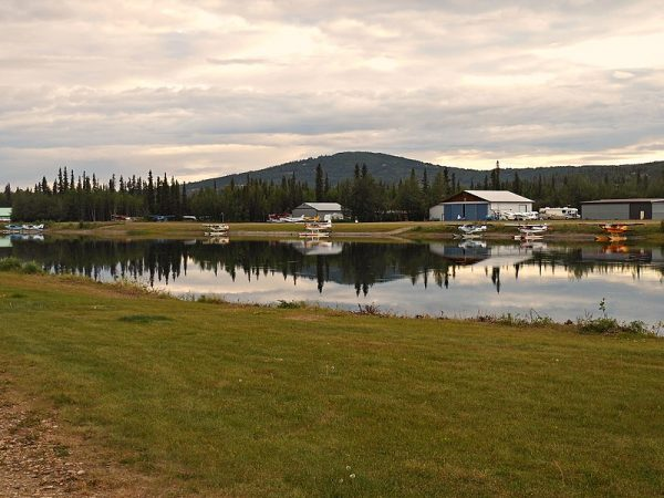 Float planes tied up in an artificial pond