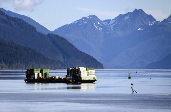 A barge filled with containers departs from the Alaska Marine Lines dock in downtown Juneau.