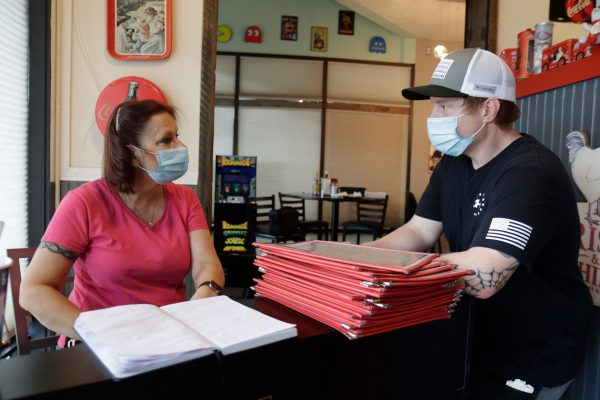Samantha Wells, owner of Little Dipper Diner, talks with assistant managerFrankie Henley at the restaurant on Thursday, Aug. 6, 2020.