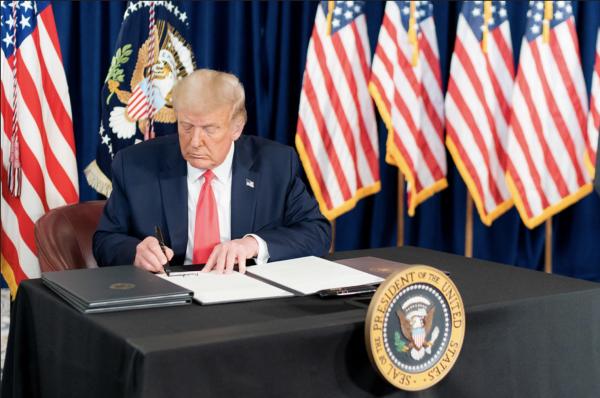 President Trump signs an executive order.