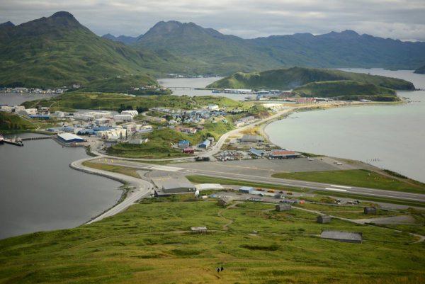 The community, runway and harbors of Unalaska from Mount Ballyhoo.