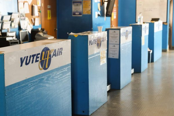 "Blue ticket counters with the logo ""Yute Air""'"