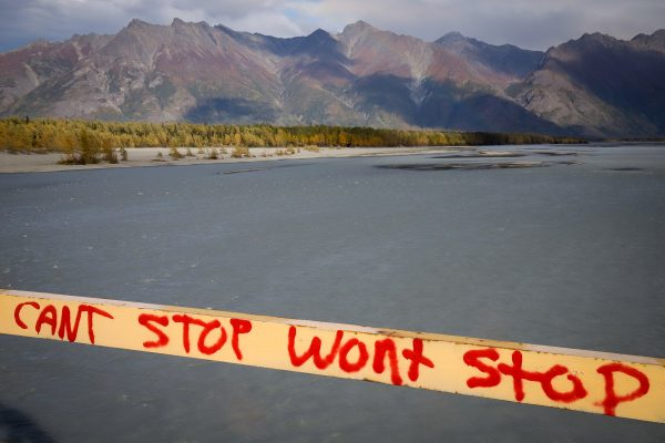 """A message that reads """"can't stop won't stop"""" in front of mountains and water"""