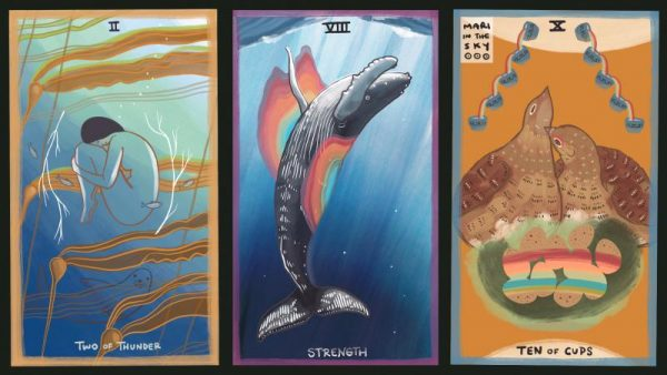 Three tarot cards next to each other one of a woman in childs pose under water, another of a humpback whale, and another o two birds in a nest.