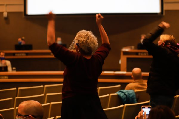 Peopleclap at the Anchorage Assembly meeting.