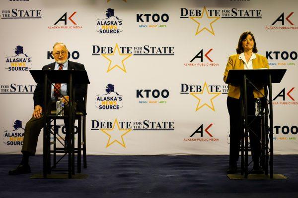two people debating behind podiums