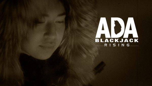 """A faint image of a woman's face ringed by the fur ruff on her parka next to lettering of the film's title, """"Ada Blackjack Rising,"""" with the space inside the D made to look like the oblong Gambel Island"""