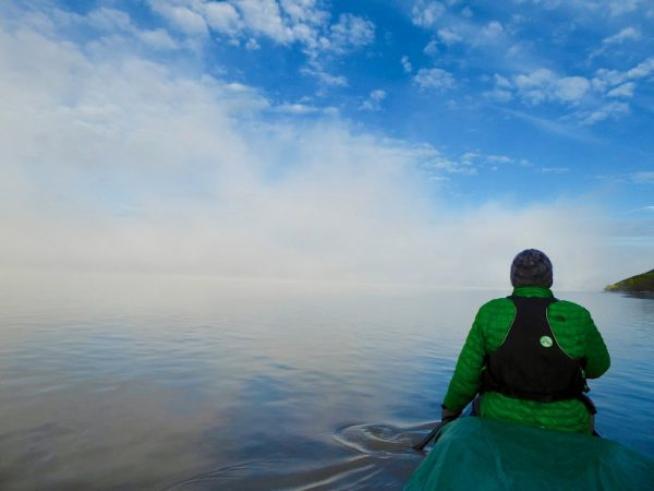 a foggy view from a canoe
