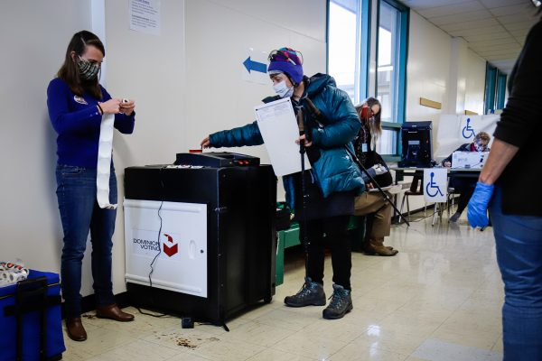 an election machine and some people on election day