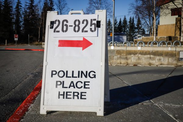 """a sign that reads """"polling place here"""""""