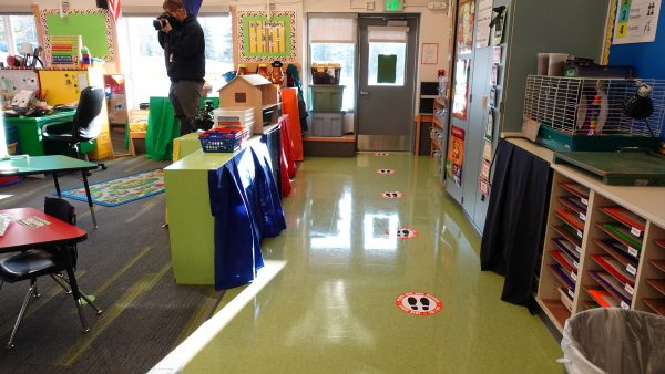 Kindergarten teacher Katie McDaniel's classroom at Huffman Elementary School on Monday, Nov. 2, 2020. Stickers on the floor aim to help students stay farther apart while lining up to go outside.