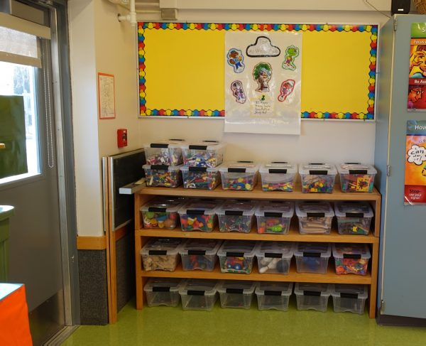 Huffman Elementary kindergarten teacher Katie McDaniel has sorted her classroom's toys into separate containers, one for each student.