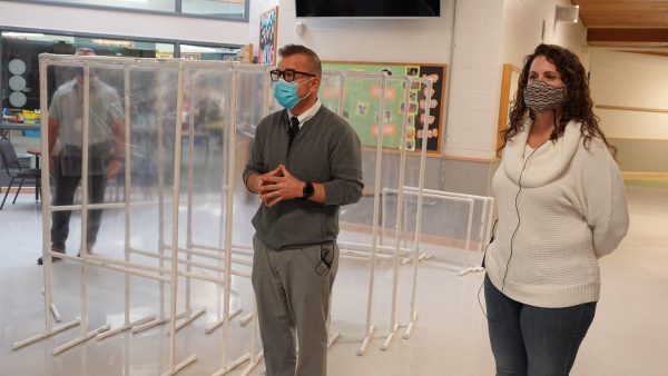 Huffman Elementary School principal Chris Opitz stands in the school lobby with kindergarten teacher Katie McDaniel.