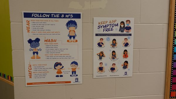 Signs in the hallways at Huffman Elementary School encourage mask wearing, hand washing and social distancing.