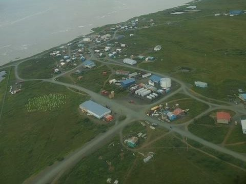 An aerial view of a small village nexxt to the ocean