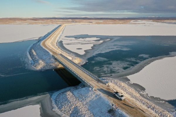 The new Kivalina Access Road stretches over an icy river in Alaska's Northwest Arctic.