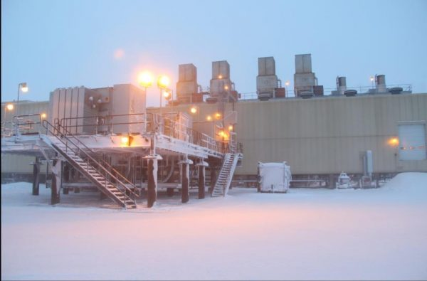 A drillng facility in low arctic light in snow