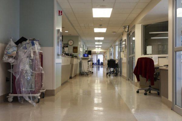 A mostly empty hospital hallway