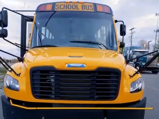 A front view of a yellow school bus