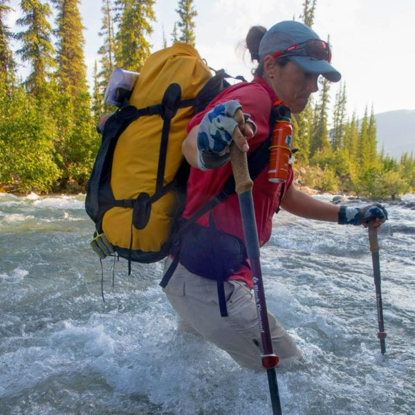 Sonja Wieck, adventure racer, wades on foot across a river.