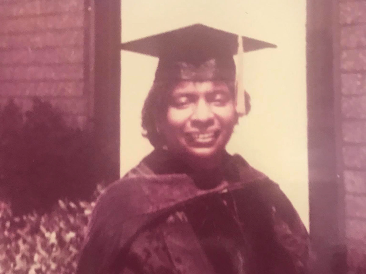 an old photo of a Black woman in a graduation gown