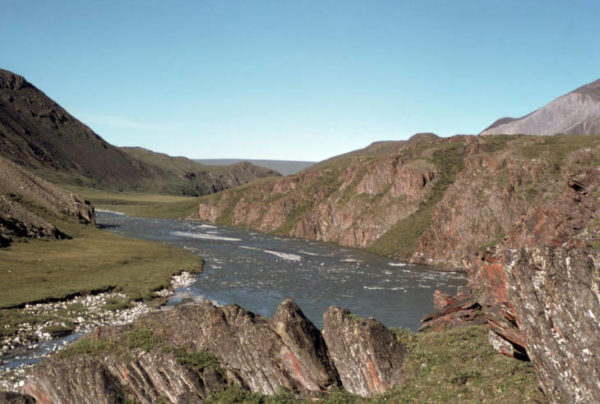 A river with jagged granite bluffs