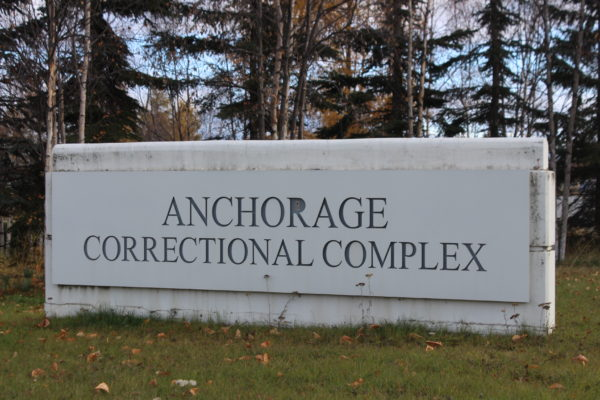 """A concrete sign with the words """"Anchorage Correctional Complex_"""