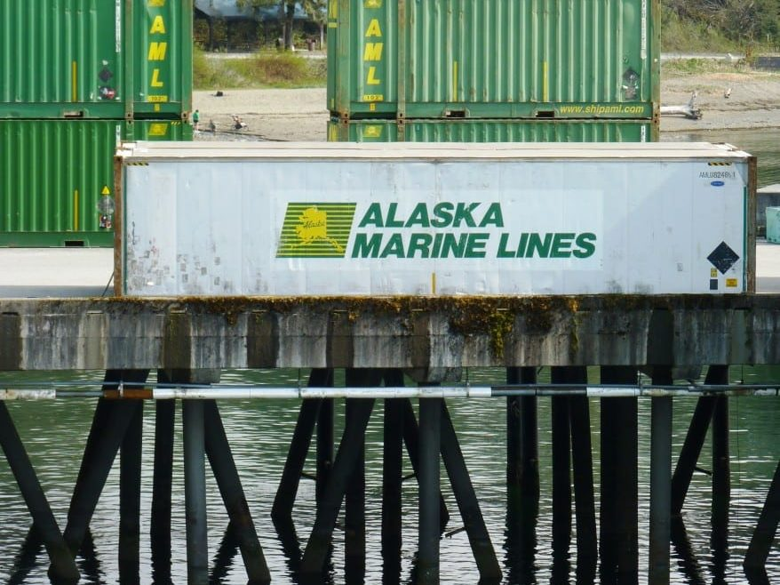 A container with the logo for Alaska Marine Lines