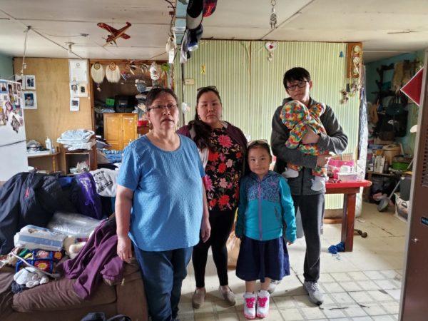 An Alaskan Native fmily inside a house