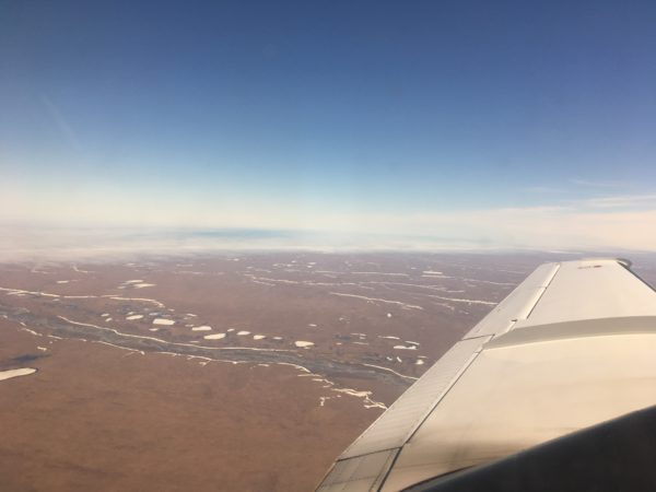 A view from an airplane of vast tundra.