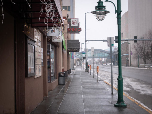 A foggy street with businesses