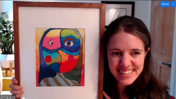 A white woman holds a colorful photo frame up to the camera
