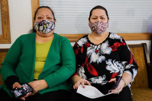 Two Islanderr women sit on a bench