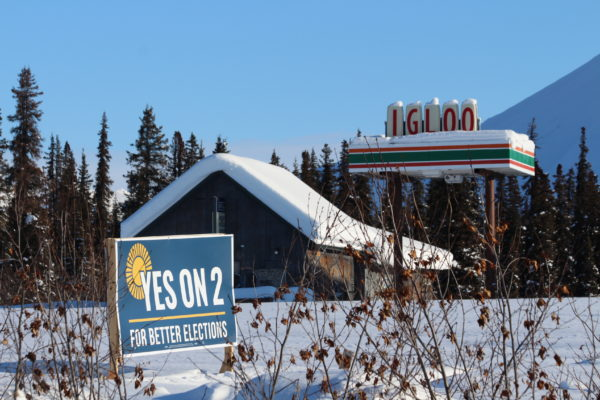 A 'yes on 2' sign next to snowy mountains