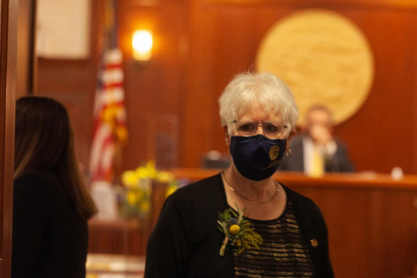 A white woman with a black mask