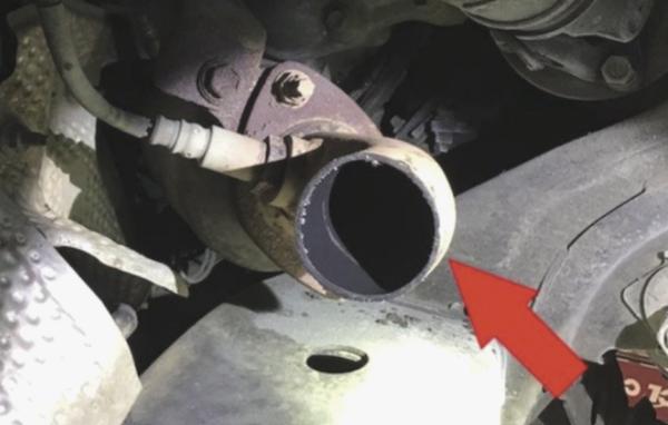 A pitpe under a car