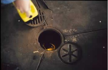 A floor drain with the lid removed