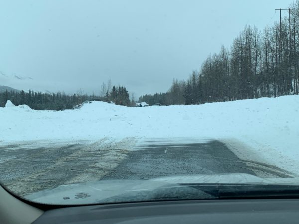 An avalanche over a road as seen from a windshield
