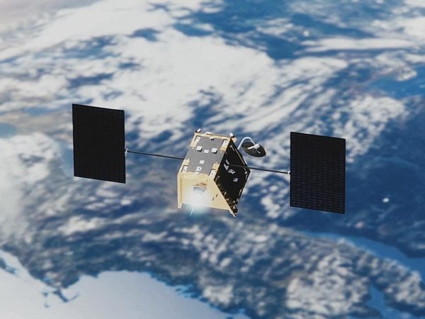 A statelite with two panels orbiting over the earth