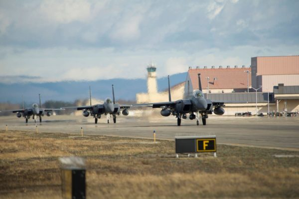 Fighter jets land on a runway