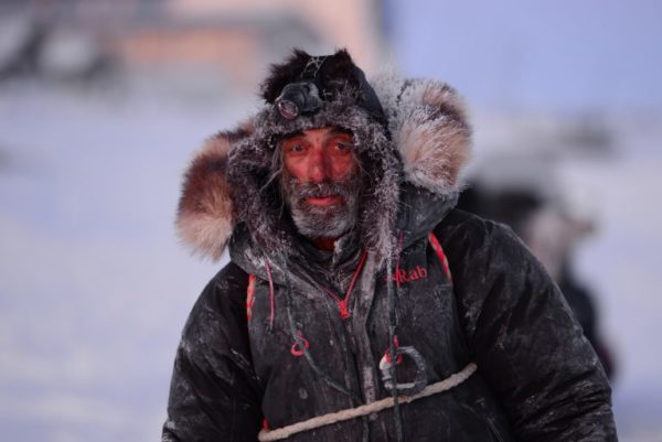 A man with a frosty hat and jacket.