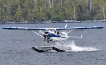 A float plane lands in the water