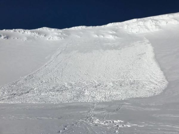 An avalanche on a ble sky day