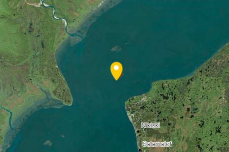 An image of water and land shows the location of a spill site, in the Cook Inlet.