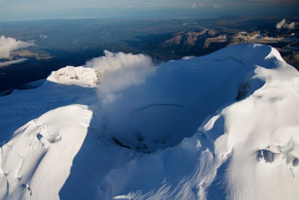 A snow-capped volcano.